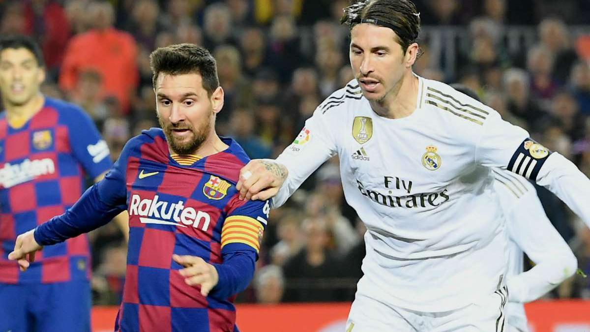 Messi e Sergio Ramos disputam jogada; Rel Madrid e Barcelona são as marcas mais valiosas do futebol