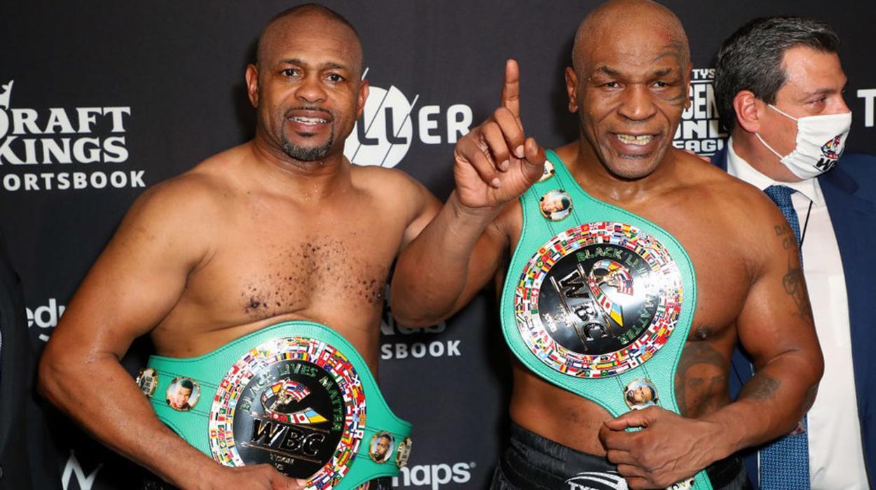 Mike Tyson e Roy Jones Jr. após a luta