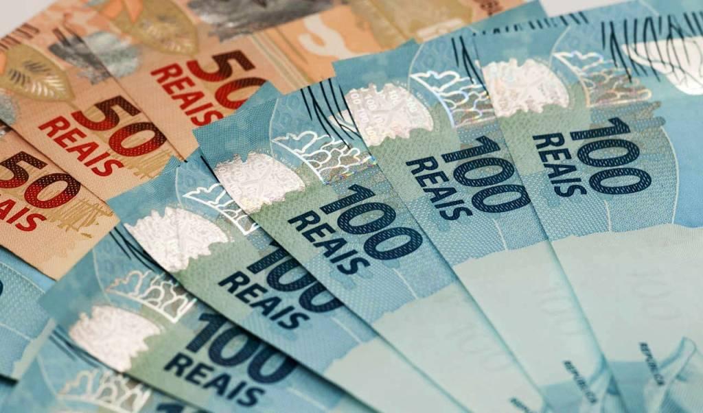 Imagem mostra dinheiro em matéria sobre sanção de projeto de regime de recuperação fiscal